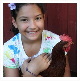 girl holding chicken