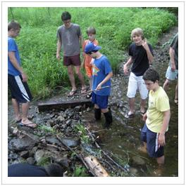 Older campers go for a creek walk.